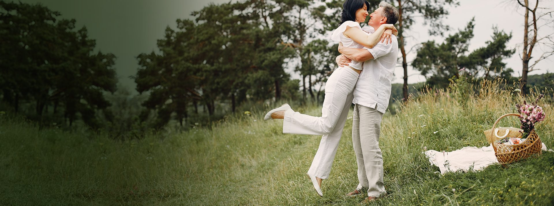 Happy Young couple on the field in spring